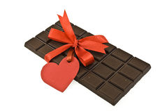 Black chocolate with red ribbon and tag. Heart Royalty Free Stock Images