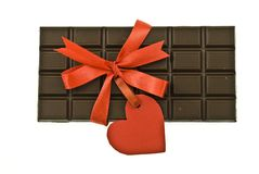 Black chocolate with red ribbon and tag  Stock Photos