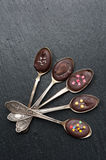 Black Chocolate  in spoons Stock Photography