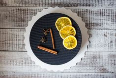 Black chocolate velour cake with dried oranges and cinnamon Royalty Free Stock Photos