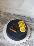 Black chocolate velour cake with dried oranges and cinnamon Royalty Free Stock Images