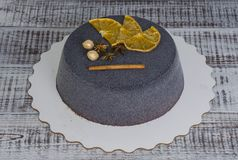 Black chocolate velour cake with dried oranges and cinnamon Stock Photo