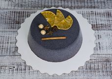 Black chocolate velour cake with dried oranges and cinnamon Stock Image
