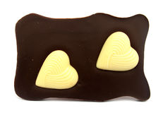 Black chocolate with white chocolate hearts on it Royalty Free Stock Photos