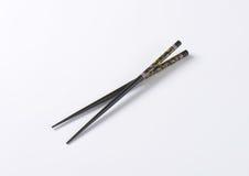 Black chopsticks Stock Images