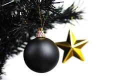 Black christmas. A black christmas ball with a gold star Royalty Free Stock Photos