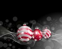 Black Christmas background with three Christmas balls. Decorative red baubles for holiday design. Vector Stock Photography