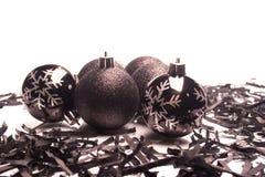 Black Christmas  balls. Isolated on white bakground Royalty Free Stock Images