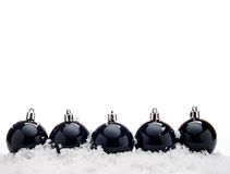 Black christmas balls with snow stock images