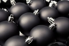 Black Christmas baubles Stock Images