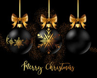 Black Christmas decoration ball with golden ribbon bow on black background. Black Christmas decoration balls collection on black background. Confetti backdrop Royalty Free Stock Images