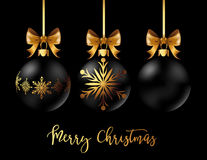 Black Christmas decoration ball with golden ribbon bow on black background. Black Christmas decoration balls collection on black background. Confetti backdrop Stock Photo