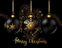 Black Christmas decoration ball with golden ribbon bow on black background. Black Christmas decoration balls collection on black background. Confetti backdrop Stock Image