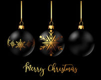 Black Christmas decoration ball with golden ribbon bow on black background. Black Christmas decoration balls collection on black background. Confetti backdrop Royalty Free Stock Photos