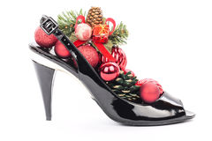 Black Christmas decorations isolated on white. Black stilettos shoes with xmas decorations Stock Image