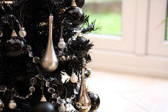 Black christmas tree. Modern Christmas tree in black with black and silver christmas balls Royalty Free Stock Photos