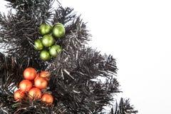 Black Christmas Tree. A black Xmas Tree with some green and orange Christmas Balls stock image