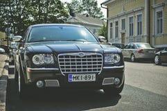 Black Chrysler 300c Parked on Road Stock Image
