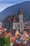 Black Church in Brasov, Romania. View of the Black Church and Mount Tampa in the background in Brasov, Romania royalty free stock photos