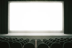 Black cinema with blank screen. Movie theater with rows of black seats and large blank screen with curtains. Mock up, 3D Rendering Stock Photography