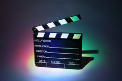 Black cinema clapperboard. Which is multicolored highlighted royalty free illustration
