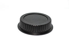 Black circle camera len cap on white background Royalty Free Stock Photo