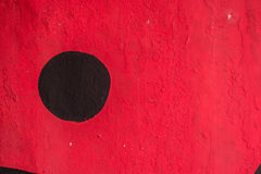 Black circle paint in a red wall. Black circle paint in a red cement wall Royalty Free Stock Photography