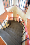 Black Circular staircase. With pole and floor background Stock Photo