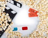 Black clapper movie, 3D-glasses, movie tickets and lot popcorn,. Black clapper movie, 3D-glasses, movie tickets and a lot of popcorn,  on white background Stock Image