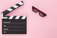Black clapperboard isolated on color background, flat lay stock image