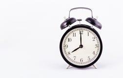 Black classic alarm clock on a white background. Black watch. Copy space. Black classic alarm clock on a white background. Black watch stock photography