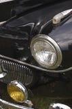 Black Classic Car. A close up of a black classic car headlight stock images