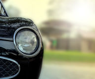 Black classic car headlight . Royalty Free Stock Image