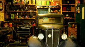 Black Classic Car Inside the Garage royalty free stock photo