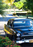 A black classic car on the street in the inland cuba Royalty Free Stock Photos