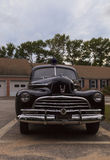Black classic Chevrolet Special Deluxe police car Stock Photos