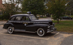 Black classic Chevrolet Special Deluxe police car Royalty Free Stock Photo