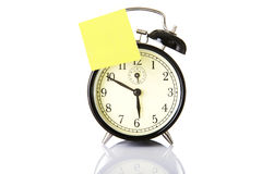Black classic style alarm clock with note Royalty Free Stock Image
