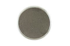 Black clay powder in a glass container Stock Photography