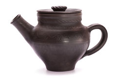 Black clay teapot. Isolated on white Royalty Free Stock Images