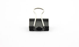 Black clerical clip for paper on white background Royalty Free Stock Images