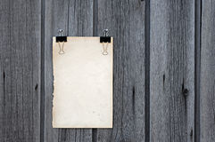 Black clip and old blank note paper hang Royalty Free Stock Photography