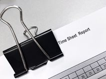 Black clip on the time sheet report Royalty Free Stock Image
