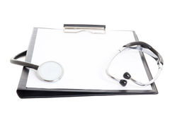 Black clipboard with blank paper sheet and stethoscope isolated Stock Photo