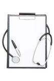 Black clipboard with blank paper sheet, stethoscope and pen isol Stock Photos