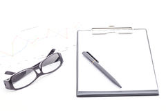 Black clipboard, pen, glasses and business graph. Stock Photography