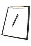 Black clipboard with pen and paper Royalty Free Stock Photography