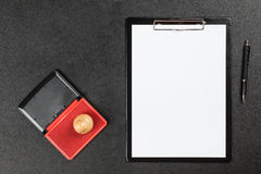 Black clipboard on a table Stock Images