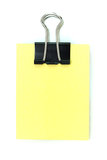 Black clipper and yellow notepad Stock Image