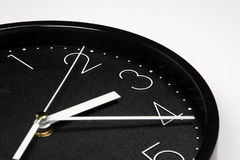 Black clock. Part of black clock on white background Stock Photography